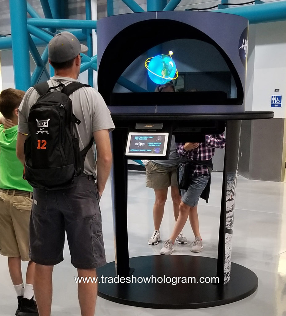 Kennedy Space Center visitors view 3D holograms